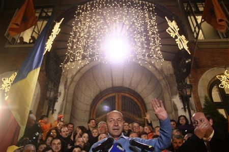 Romania's incumbent President Traian Basescu addresses his supporters after the first exit polls of presidential elections in Bucharest December 6, 2009. REUTERS/Mihai Barbu