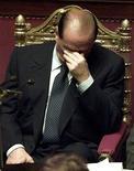 <p>Премьер-министр Италии Сильвио Берлускони после выступления в Сенате 28 сентября 2001 года. У итальянцев теперь появилась возможность поколоть иглами своего премьера - недавно начался выпуск кукол вуду в виде Сильвио Берлускони, покрытых избранными цитатами политика. REUTERS/Dylan Martinez</p>
