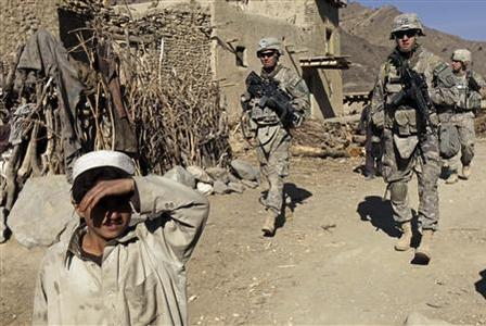 An Afghan boy covers his face from the sun during a patrol by U.S Army soldiers from Task Force Yukon 1-40 CAV combat team at Shadal village in Khowst province, Afghanistan, December 7, 2009. REUTERS/Zohra Bensemra