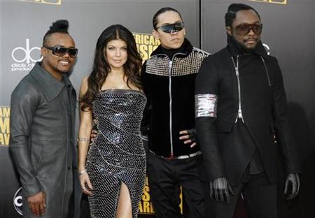 Members of the band Black Eyed Peas arrive at the 2009 American Music Awards in Los Angeles, California November 22, 2009. REUTERS/Danny Moloshok