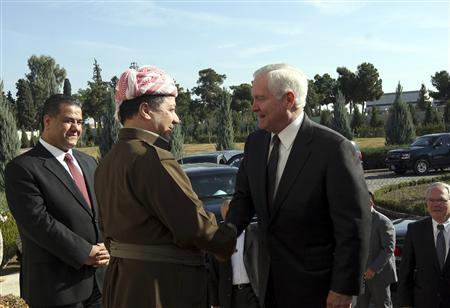 President of Iraq's autonomous Kurdistan region Massoud Barzani (2nd L) shakes hands with U.S. Secretary of Defense Robert Gates in Arbil, 310 km (190 miles) north of Baghdad, December 11, 2009. REUTERS/Azad Lashkari