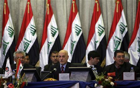 Members of the Iraqi oil committee who will judge bids are seen during the second bidding round for oilfields, in Baghdad December 12, 2009. REUTERS/ Thaier al-Sudani