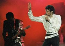 <p>Michael Jackson performs during a Victory Tour concert in Toronto, in this October 5, 1984 file photo. REUTERS/Gary Hershorn/Files</p>