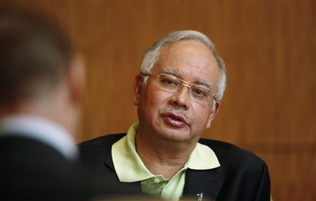 Malaysia's Prime Minister Najib Razak speaks to Reuters during an interview in Kuala Lumpur December 13, 2009. Malaysia will issue a small international bond next year to part fund its budget deficit, although the majority of the expected deficit of 5.6 percent of gross domestic product will be funded domestically, Najib told Reuters on Sunday. REUTERS/Bazuki Muhammad