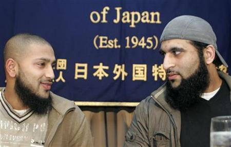 Ruhal Ahmed and Shafiq Rasul (R), British citizens who were detained at the U.S. Guantanamo naval base as terror suspects, answer questions at a news conference to promote the film ''The Road to Guantanamo'' in Tokyo January 11, 2007. REUTERS/Kim Kyung-Hoon