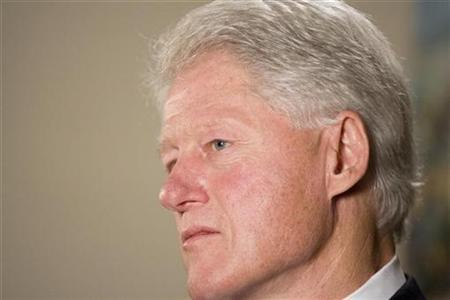 Former President Bill Clinton poses for a portrait in New York December 7, 2009. REUTERS/Lucas Jackson