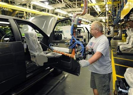 An employee works on the new 2009 Ford F-150 on the assembly line at Ford's Kansas City Assembly Plant in Claycomo, Missouri October 2, 2008. REUTERS/Sam VarnHagen/Ford Motor Co/Handout