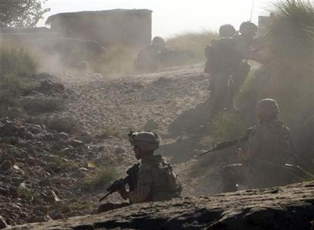 U.S. Marines of the 8th Regiment Second Battalion take up positions after coming under fire from Taliban insurgents in the Mian Poshtay area in Helmand province, October 20, 2009. REUTERS/Asmaa Waguih
