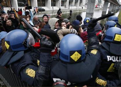 Police officers clash with protesters during a demonstration outside the United Nations Climate Change Conference 2009 in Copenhagen December 16, 2009. REUTERS/Christian Charisius