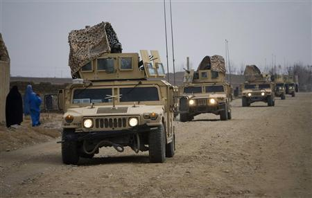 U.S. military vehicles of NATO's International Security Assistance Force (ISAF) travel on a road in Siavashan village near Herat December 14, 2009. REUTERS/Morteza Nikoubazl