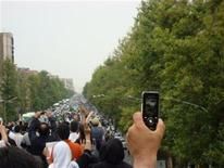 <p>A man uses a mobile phone to record images of a protest in Tehran in this undated photo made available June 22, 2009. REUTERS via Your View</p>