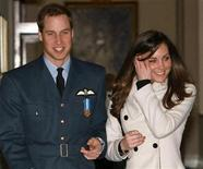 <p>Britain's Prince William (L) smiles as he walks with his girlfriend Kate Middleton at RAF Cranwell, central England April 11, 2008. REUTERS/Michael Dunlea/Pool</p>