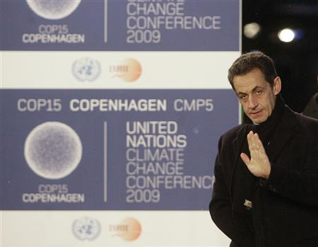 French President Nicolas Sarkozy arrives at the morning session of United Nations Climate Change Conference 2009 in Copenhagen December 18, 2009. REUTERS/Ints Kalnins