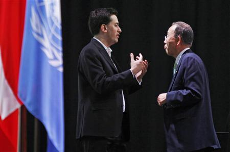 Britain's Energy Minister Ed Miliband (L) speaks to UN Secretary General Ban ki-Moon during a plenary meeting at the UN Climate Change Conference 2009 in Copenhagen December 19, 2009. REUTERS/Bob Strong
