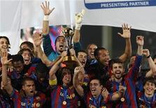 <p>O Barcelona, da Espanha, venceu o Mundial de Clubes da Fifa neste sábado ao bater o argentino Estudiantes de La Plata por 1 x 0 na prorrogação, após empatar em 1 x 1 no tempo regulamentar. REUTERS/Amr Abdallah Dalsh</p>