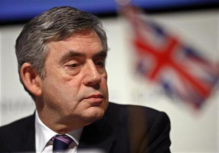 Britain's Prime Minister Gordon Brown is seen at the United Nations Climate Change Conference at the Bella Center in Copenhagen December 18, 2009. World leaders tried to save a climate deal from collapse over a stand-off between rich and developing nations on Friday, the last day of U.N. talks meant to agree a new global pact. REUTERS/Sren Bidstrup/Scanpix