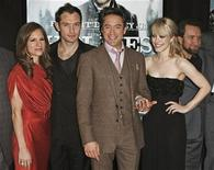 "<p>Cast members Jude Law (2nd L), Rachel McAdams (2nd R), and Robert Downey Jr. (C) attend the premiere of ""Sherlock Holmes"" with Downey Jr.'s wife, Susan Downey (L) in New York December 17, 2009. REUTERS/Finbarr O'Reilly</p>"