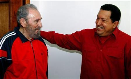 Cuba's President Fidel Castro shares a moment with his Venezuelan counterpart Hugo Chavez in Havana, January 29, 2007. REUTERS/Juventud Rebelde/Handout