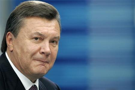 Regions Party leader Viktor Yanukovich listens to a journalist's question during a news conference in Kiev, in this August 27, 2009 file photo. REUTERS/Konstantin Chernichkin