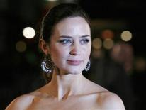 "<p>British actress Emily Blunt poses for photographers as she arrives for the World Premiere of ""Young Victoria"" at Leicester Square in London in this March 3, 2009 file photo. REUTERS/Luke MacGregor</p>"