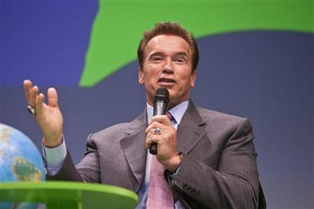 Arnold Schwarzenegger, governor of the state of California, gestures during a debate at the Climate Summit for Mayors at the Copenhagen City Hall December 16, 2009. REUTERS/Scanpix/Anders Debel Hansen