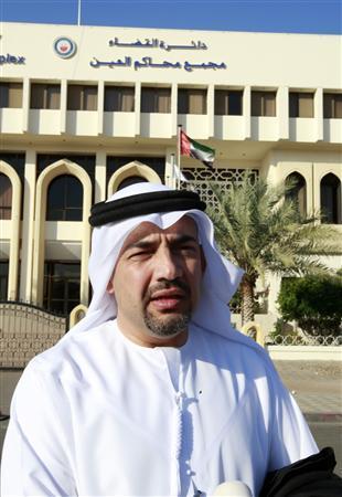 Habib al-Mulla, a lawyer for Sheikh Issa bin Zayed al-Nahyan, stands outside a court in AL-Ain January 10, 2010. RUTERS/Mosab Omar