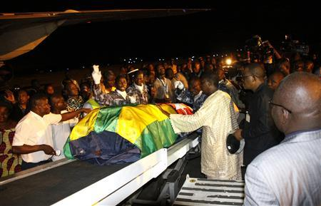 Togolese government officials and relatives receive the remains of Togolese assistant football coach Amalete Abalo in the capital Lome, January 10, 2010. REUTERS/Noel Kokou Tadegnon