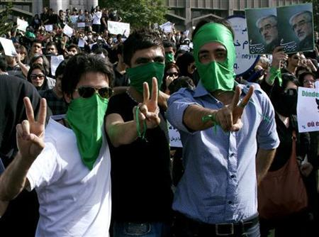 EDITORS' NOTE: Reuters and other foreign media are subject to Iranian restrictions on leaving the office to report, film or take pictures in Tehran Supporters of defeated Iranian presidential candidate Mirhossein Mousavi gesture during a protest in Tehran on June 18, 2009 in this picture uploaded on June 21, 2009. REUTERS via Your View