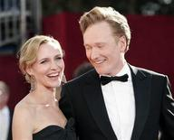 <p>NBC's Tonight Show host Conan O'Brien (R) and wife Liza Powell arrive at the 61st annual Primetime Emmy Awards in Los Angeles, California September 20, 2009. REUTERS/Danny Moloshok</p>