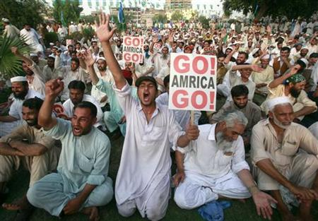 A man shouts ''Allahu Akbar,'' or God is great, during an anti-American rally in the north west Pakistan city Peshawar August 9, 2009. REUTERS/Ali Imam