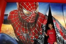 "<p>A man laughs after watching a ""Spider-Man 3"" promotional video in Hong Kong May 2, 2007. REUTERS/Claro Cortes IV</p>"