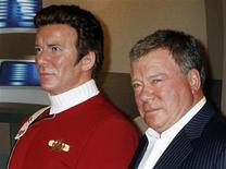 """<p>Canadian actor William Shatner (R) poses as he unveils a wax figure of himself as character Captain James T. Kirk from the """"Star Trek"""" television series at Madame Tussauds Hollywood November 4, 2009. REUTERS/Fred Prouser</p>"""