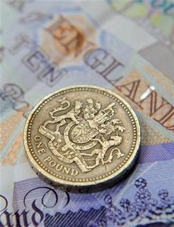 A one pound coin and sterling notes are seen in central London June 17, 2008 file photo. REUTERS/Toby Melville