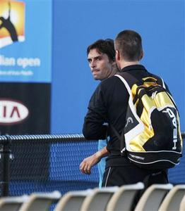 Brazil's Marcos Daniel is retrained by a member of his team after having a physical altercation with a spectator following his match against Alejandro Falla of Colombia at the Australian Open tennis tournament in Melbourne January 19, 2010. REUTERS/Tim Wimborne
