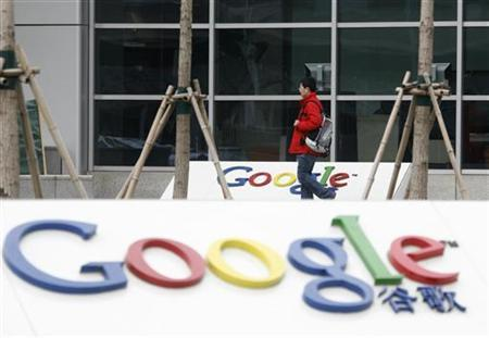 A man walks past the logo of Google China outside its company headquarters in Beijing, January 20, 2010. REUTERS/Barry Huang