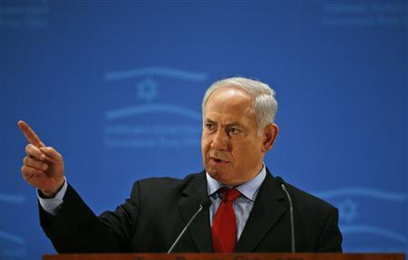 Israel's Prime Minister Benjamin Netanyahu gestures as he addresses members of the foreign media during a reception in Jerusalem January 20, 2010. REUTERS/Baz Ratner