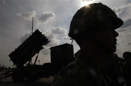 A member of Japan's Self-Defence Forces stands next to the Patriot Missile System at an exhibition during the Security and Safety Trade Expo in Tokyo October 17, 2007. REUTERS/Kim Kyung-Hoon