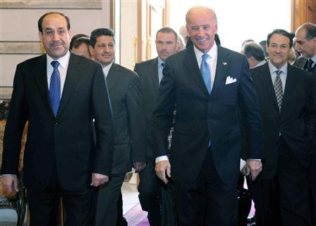 Iraq's Prime Minister Nuri Al-Maliki (L) walks beside U.S. Vice President Joe Biden (C) as Biden arrives at the press centre of the Council of Ministers in Baghdad January 23, 2010. Iraqi government spokesman Ali al-Dabbagh is at right. REUTERS/Iraqi Government/Handout
