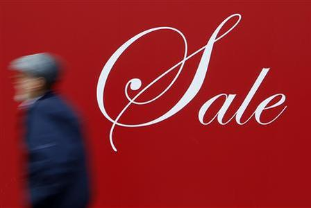 A man walks past a shop window displaying a sale sign in central London January 25, 2010. REUTERS/Stefan Wermuth