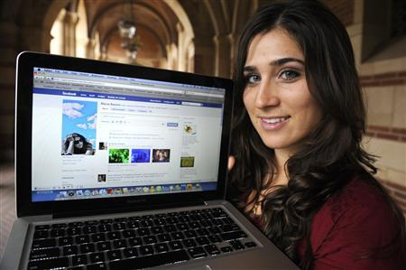 Alyssa Ravasio displays her page on the social networking site Facebook, while attending school in Los Angeles January 26, 2010. REUTERS/Phil McCarten