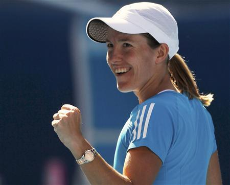 Justine Henin of Belgium celebrates her semi-final win over China's Zheng Jie at the Australian Open tennis tournament in Melbourne January 28, 2010. REUTERS/Daniel Munoz