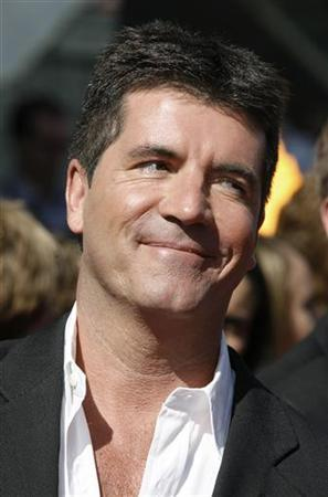 Simon Cowell, one of the judges, poses as he arrives for the finale of the television reality series ''American Idol'' in Hollywood, California in this May 23, 2007 file photo. REUTERS/Fred Prouser