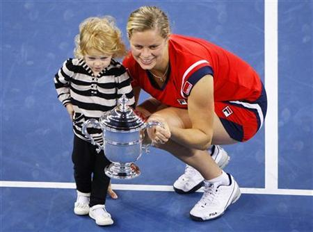 Kim Clijsters of Belgium and her daughter Jada pose with the trophy after she defeated Caroline Wozniacki of Denmark in the women's singles final match at the U.S. Open tennis tournament in New York, September 13, 2009. REUTERS/Shaun Best