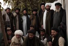 <p>Greg Mortenson (3rd R - back) poses with tribal elders from Urozgan province in southern Afghanistan September 2009. Central Asia Institute has established the first girls high school in this province, which is a Taliban stronghold. REUTERS/Sarfraz Khan/Central Asia Institute</p>
