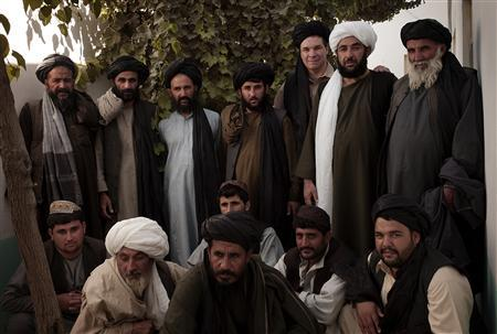Greg Mortenson (3rd R - back) poses with tribal elders from Urozgan province in southern Afghanistan September 2009. Central Asia Institute has established the first girls high school in this province, which is a Taliban stronghold. REUTERS/Sarfraz Khan/Central Asia Institute