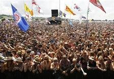 <p>Fans wave as The Spirit performs at the Glastonbury Festival 2009 in south west England June 27, 2009. REUTERS/Luke MacGregor</p>