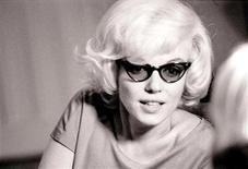 <p>La actriz Marilyn Monroe en una fotografía tomada en diciembre de 1961 en Nueva York. divulgada el 5 feb 2010. Fotografías de Marilyn Monroe con aspecto relajado en un apartamento de Nueva York nueve meses antes de morir salieron el viernes a la luz pública, después de estar en un archivo privado durante más de 45 años. REUTERS/Len Steckler/Handout</p>