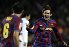 <p>O jogador argentino Lionel Messi, do Barcelona, comemora seu gol conte o Getafe, em Barcelona. REUTERS/Albert Gea</p>