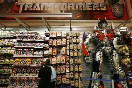 A woman shops for Transformers toys made by Hasbro, in New York, October 19, 2009. REUTERS/Shannon Stapleton