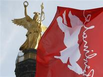 <p>A flag with the logo of the Berlinale International Film Festival flies in front of the Victory Column (Siegessaeule) in Berlin February 9, 2010. REUTERS/Thomas Peter</p>